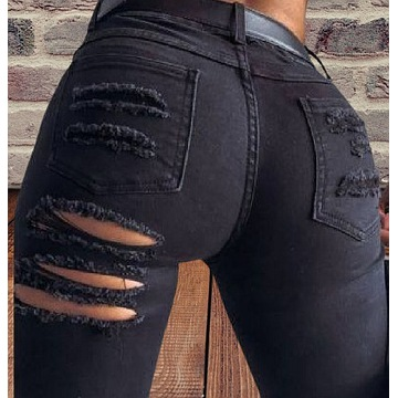 Spodnie dżinsowe dziury z tyłu pod posladkiem 36 S