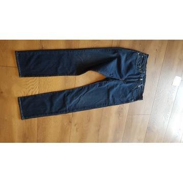 Spodnie Levis 511 ,34/32 nowe.Ładne przetarcia.