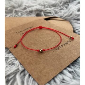 Czerwona bransoletka szczęścia kulka złota damska