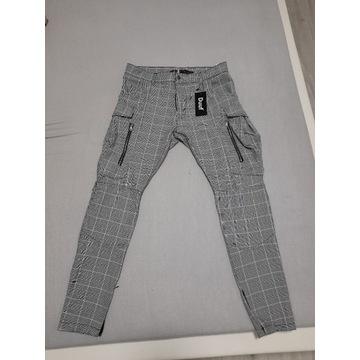 Nowe spodnie chinosy Duuf rozm. 33
