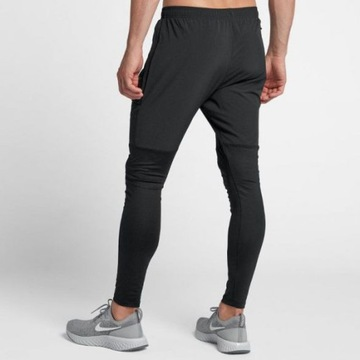 spodnie NIKE ESSNTL HYBRID AA4199-010 S 173cm