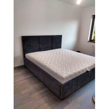 Łóżko tapicerowane w modnym wzorze