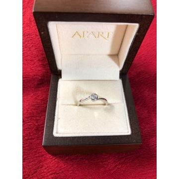 Złoty pierścionek 750 z diamentem 0,15ct
