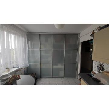 Drzwi przesuwne szklane, aluminium i szkło