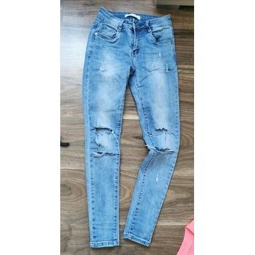 Spodnie jeansy skinny rurki Redial dziury xs 34