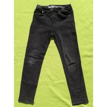 Spodnie dżinsowe H&M czarne rozmiar 152