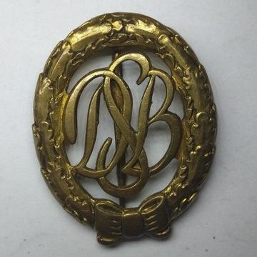 Odznaka sportowa , brąz pozłocony