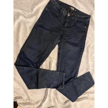 Granatowe marmurkowe spodnie rurki klasyczne z wyż