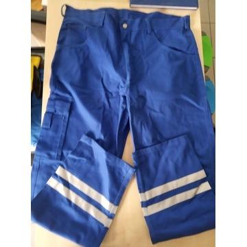 Niebieskie spodnie robocze  z odblaskami