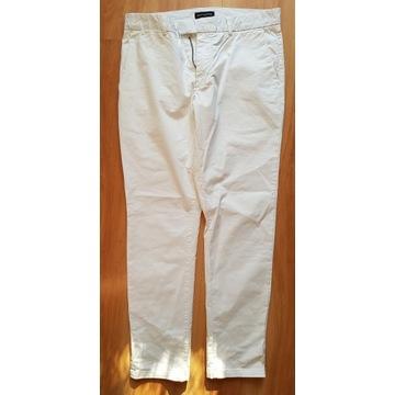 męskie spodnie bawełniane białe chinosy Wólczanka