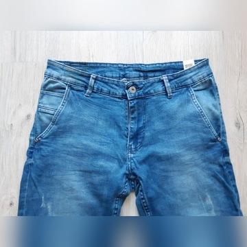 Spodnie chino jeans Reserved 32