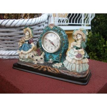 zegar kwarcowy z figurkami