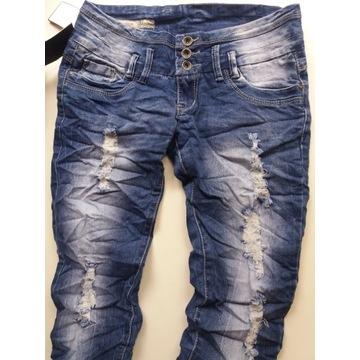 Spodnie jeans przecierane dziury