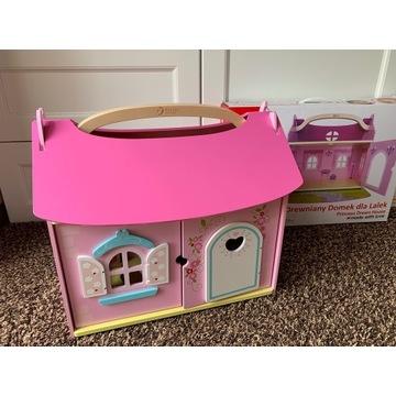 Drewniany domek dla lalek z wyposażeniem różowy
