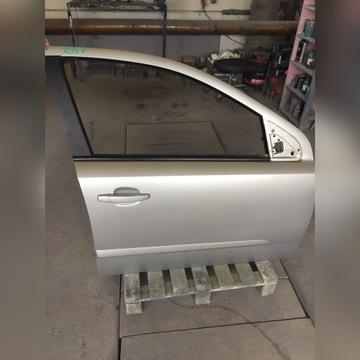 Drzwi prawy przód Opel Astra h kod koloru z157