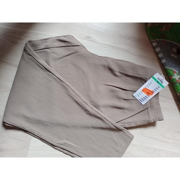 Śliczne materiałowe spodnie XL Sinsay