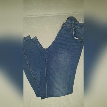 Spodnie reserved 40 push up dżinsy