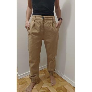 Spodnie Joggery Bershka beżowe 38 M
