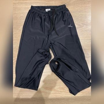 Spodnie gimnastyczne z zapiętkami rozm.143-152