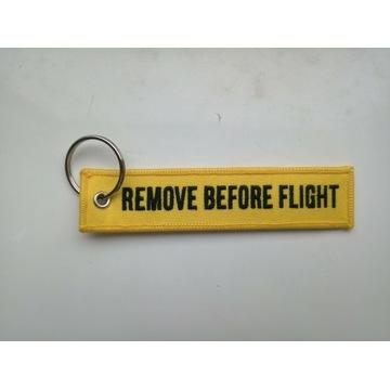 Zawieszak żólty na bagaż, klucze Remove before