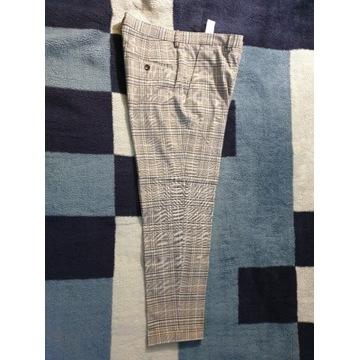 Spodnie garniturowe w kratkę marki Zara