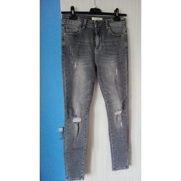 Szare siwe spodnie z rozcięciami dziurami M