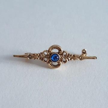 Pozłacana broszka - niebieski kamień