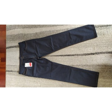 Nowe eleganckie spodnie dżinsowe. Rozmiar 44