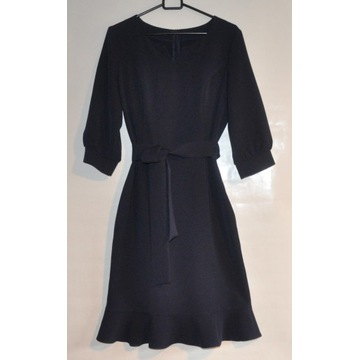 Sukienka o kroju a'la syrenka
