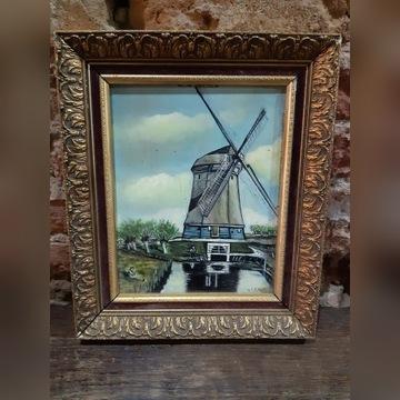 obraz wiatrak w rzeźbionej ramie