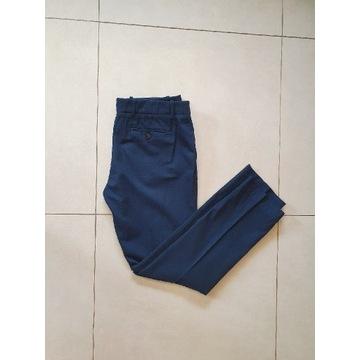 Oryginalne granatowe spodnie Lacoste xl 42