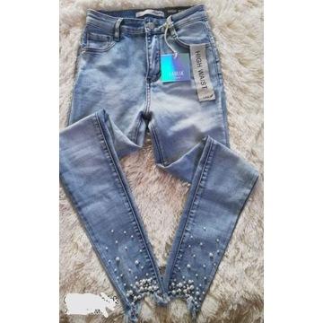 Spodnie jeansy rurki  7/8  wyższy Stan roz 36