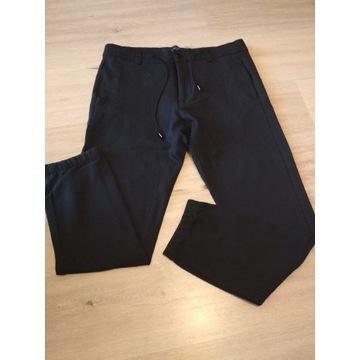 Spodnie materiałowe Zara