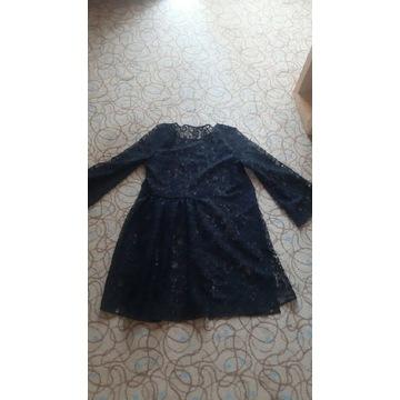 Czarna sukienka koronkowa plażowa