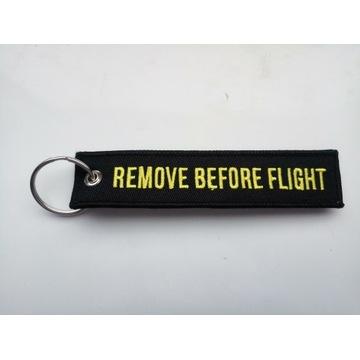 Zawieszak czarny na bagaż, klucze Remove before