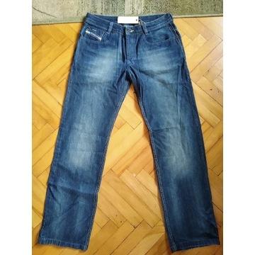 Nowe Spodnie jeans Diesel model Levan rozmiar 33