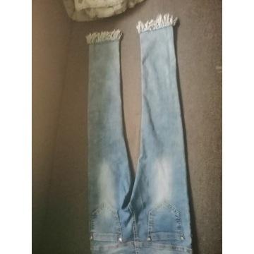 Śliczne jasnoniebieskie jeansy dziewczęce 146/152