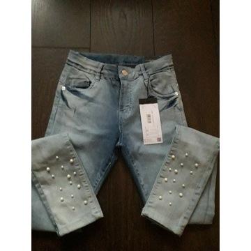 Nowe spodnie Jeansowe Reporter