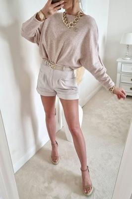Sweterek z broszką pudrowy róź