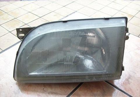 LAMPA LEWY ПЕРЕДНИЙ 0374D 95VG-13006-AA FORD TRANSIT