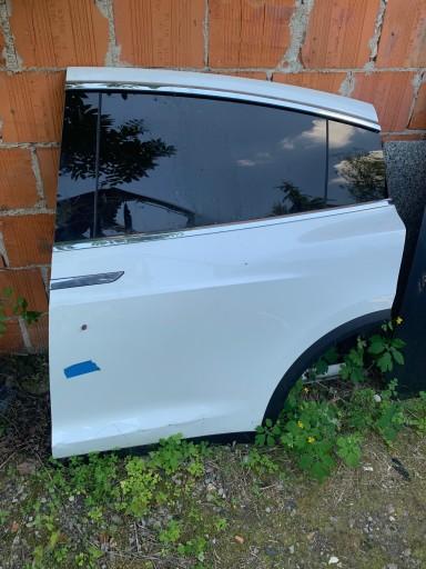 Tesla X drzwi tylne lewe kompletne 1069537-E0-A