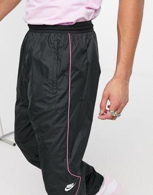 NIKE SPODNIE DRESOWE CZARNE Z LOGO MĘSKIE M AAF 10773641530 Odzież Męska Spodnie IK NLQNIK-1